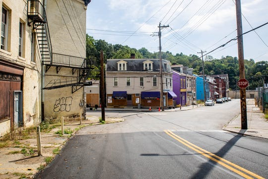 Jamie Younger owns and operates Young Brothers Bar, pictured on the corner of Woods Run and McClure Avenues, on the border of the Woods Run and Brighton Heights neighborhoods of Pittsburgh. Young Brothers sits about a mile from the county's ALCOSAN water treatment facility.