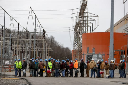 Workers line up at the gates to punch out after their shifts at TVA Cumberland Fossil Plant in Cumberland City, Tenn. on Tuesday.