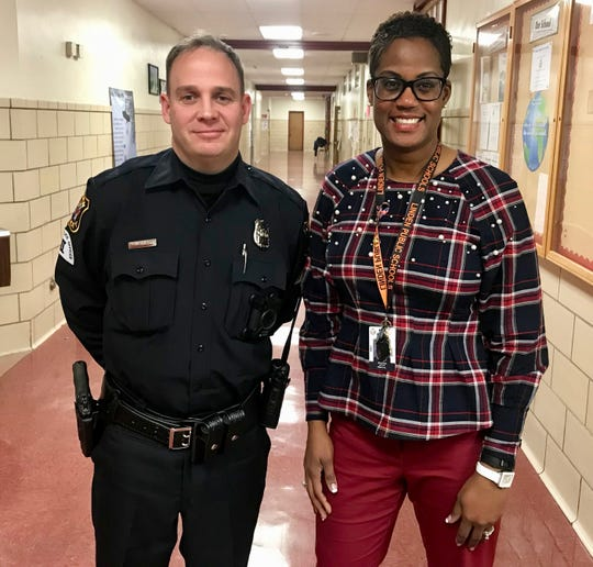 Linden Special Officer George Allard and McManus Middle School Principal Atiya Perkins.
