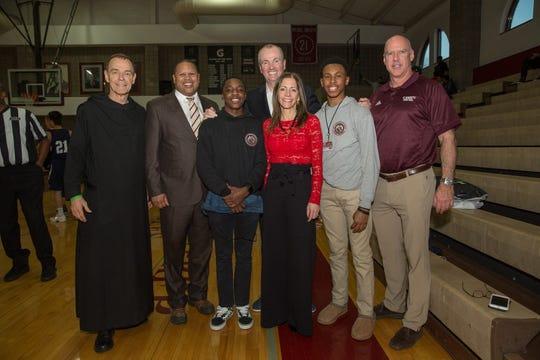 Left to right, Father Edwin Leahy, Head of School of St. Benedict's Preparatory School in Newark; John Sharpe James, Newark councilman; Jamar Ricketts, class of 2020; Gov. Phil Murphy; Tammy Murphy; Olatunji Adewole, class of 2020; and Mark Taylor, head basketball coach.