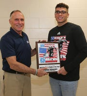 Marcus Borden presents South River's Steven Rodriguez with the Borden's Baller of the Year plaque.