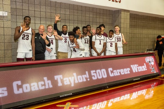 Mark Taylor celebrates 500th career win with his team.
