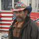"William Stark of Des Moines displayed ""flags,"" painted on wooden pallets, Dec. 10, 2019, outside his home in the 6000 block of Southwest 15th Street. One of the painted pallets featured a swastika."