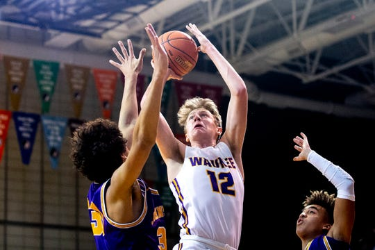 Waukee's Tucker DeVries shoots the ball during the Johnston at Waukee boys' basketball game on Wednesday, Dec. 11, 2019, in Waukee.