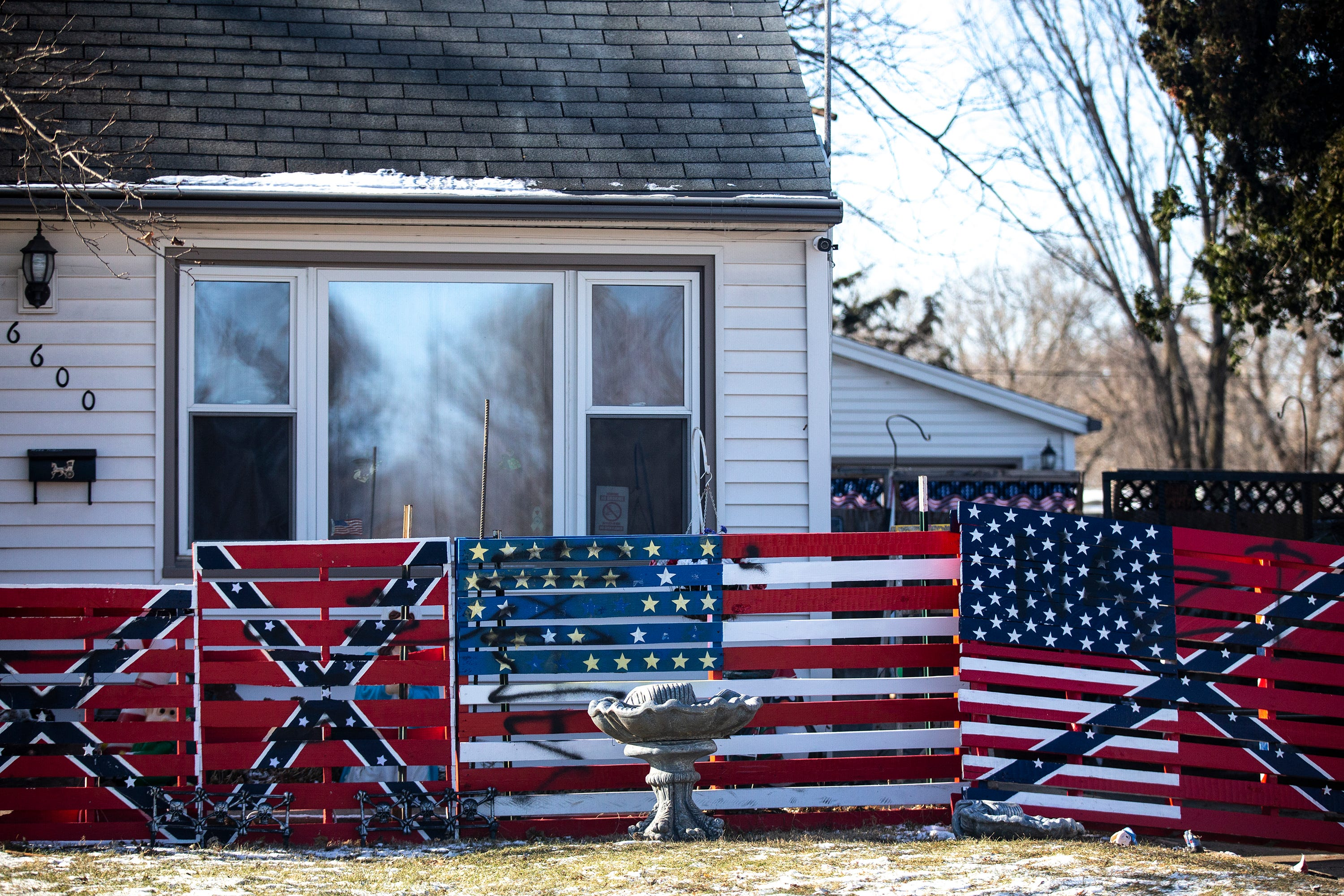 Photos of Des Moines man's painted pallets that include swastika