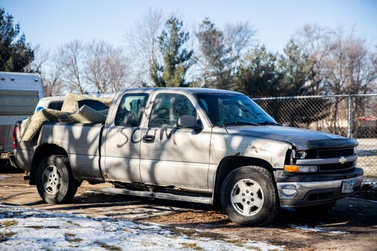 A Des Moines man's truck and display of a swastika and Confederate flags painted on wood pallets has been vandalized with the words ÒNazi scumÓ on Wednesday, Dec. 11, 2019, in Des Moines.