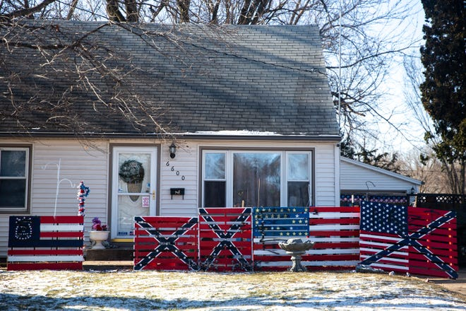 A Des Moines man's display of a swastika and Confederate flags painted on wood pallets has been vandalized with the words ÒNazi scumÓ on Wednesday, Dec. 11, 2019, in Des Moines.