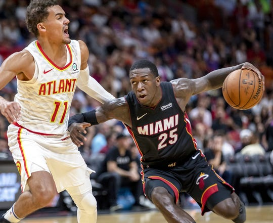 Miami Heat guard Kendrick Nunn (25) drives into the paint against Atlanta Hawks guard Trae Young (11) during the second quarter on Tuesday, Dec. 10, 2019 at AmericanAirlines Arena in Miami, Fla.