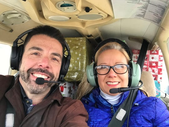 Eric and Julie Kaufman pictured on their way to deliver gifts for local foster care agencies in Big Rapids, Mich.