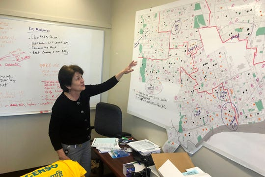 In this Nov. 22 photo, Detroit 2020 Census Campaign executive director Victoria Kovari looks over a Detroit map showing city neighborhoods that were under-counted in the 2010 census.