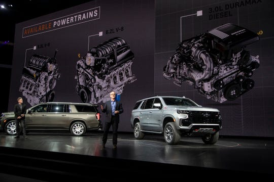 Tim Herrick, GM vice president for Global Product Programs, center, speaks as General Motors reveals new 2021 the Chevrolet Suburban High Country and Tahoe Z71 at the Little Caesars Arena in downtown Detroit, Tuesday, Dec. 10, 2019.