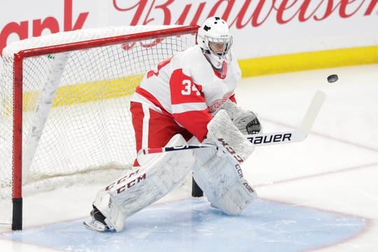 Detroit Red Wings goaltender Eric Comrie (34) warms up before a game against the Winnipeg Jets at Bell MTS Place on Tuesday, Dec. 10, 2019, in Winnipeg, Manitoba.
