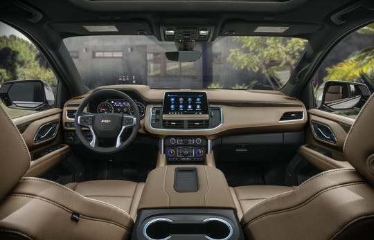 The inside of the 2021 Chevy Suburban with a touchscreen in the front dashboard.