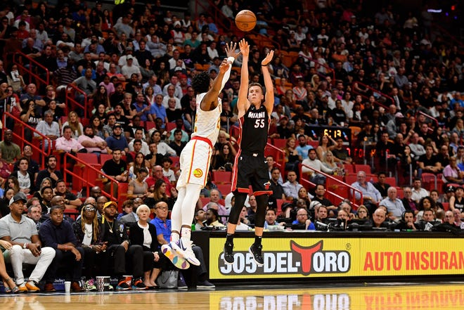 Miami Heat forward Duncan Robinson (55) attempts a three pointer over Atlanta Hawks forward Cam Reddish (22) during the second half at American Airlines Arena on Tuesday, Dec. 10, 2019 at AmericanAirlines Arena in Miami, Fla.