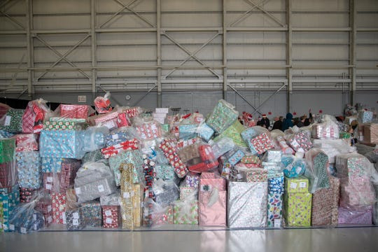 Gifts are wrapped and ready to be loaded onto a truck during the Operation Good Cheer at the Oakland County Airport in Waterford, Friday, Dec. 6, 2019.