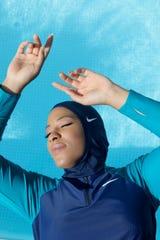 Olympic fencer, Ibtihaj Muhammad, wearing Nike's modest swimwear, Victory Collection