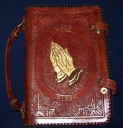 A leather Bible cover by Derrick Hampton.