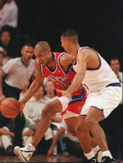 Juwan Howard, right, of the Washington Bullets, reaches around and tries to steal the ball from Grant Hill of the Detroit Pistons, Sunday, Oct. 29, 1995, at the Palacio de Deportes in Mexico City. (AP Photo/Jose Luis Magana)