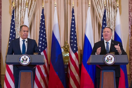 Russian Foreign Minister Sergey Lavrov, left, listens as Secretary of State Mike Pompeo speaks during a media availability, after their meeting at the State Department, Tuesday, Dec. 10, 2019, in Washington.