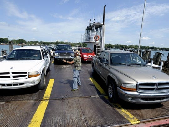 Police said crews were fixing an unknown issue with the dock when they struck a power line that fell, landing on top of a pickup truck near the St. Clair River.