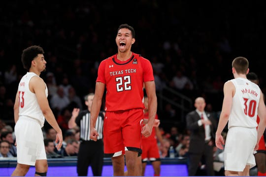 Texas Tech forward TJ Holyfield (22) reacts with Louisville forward Jordan Nwora (33) and guard Ryan McMahon (30) turning their backs on the celebration during the second half Tuesday in New York. Texas Tech defeated No.1 Louisville 70-57.
