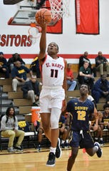 Orchard Lake's Lorne Bowman II (11) drives to the basket past Denby's Anthony Harris (12) in the first half.