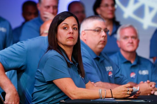 Cindy Estrada, vice president for the UAW's Fiat Chrysler department, listens to opening talks between the automaker and the union in July. UAW members have approved the labor contract.