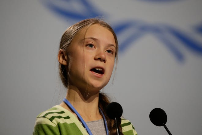 Swedish climate activist Greta Thunberg addresses plenary of U.N. climate conference during with a meeting with leading climate scientists at the COP25 summit in Madrid, Spain, Wednesday, Dec. 11, 2019.