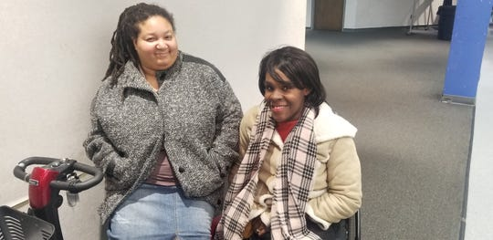 Jamie Junior (L) and Tameka Citchen-Spruce, two disability advocates attended the Detroit Charter Commission meeting Tuesday evening.
