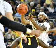 Michigan's Zavier Simpson is averaging a career-best 12.3 points a game.