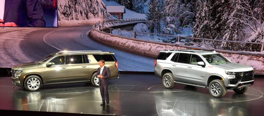GM President Mark Reuss introduces the 2021 Chevrolet  Suburban High Country, left, and Chevy Tahoe Z-71 on Tuesday night at Little Caesars Arena.