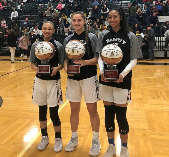 Elmira 1,000-point scorers, from left, Kiara Fisher, Morgan Gentile and Zaria DeMember-Shazer during a pregame ceremony recognizing their milestones before an 88-26 win over Vestal in girls basketball Dec. 10, 2019 at Elmira High School.