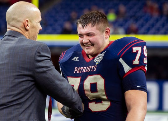 Heritage Hills' Mark Doyle (79) receives his runner-up medal after the Heritage Hills vs Bishop Chatard IHSAA State Football Game at Lucas Oil Stadium in Indianapolis, Ind., Friday, Nov. 29, 2019.