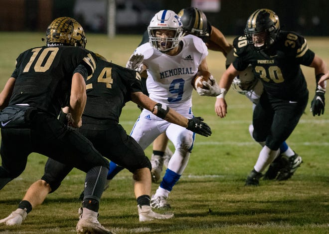 Memorial's Josh Russell (9) runs against Boonville during the 4A sectional semifinal at Boonville on Nov. 1, 2019. The junior finished second on the team in rushing and fifth in tackles last year.