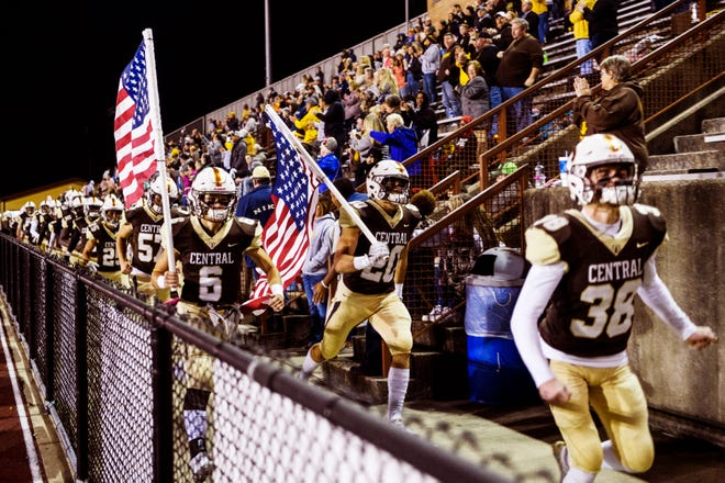 The Central Bears walk by their fans as they make their way onto the football field to take on the Reitz Panthers in the IHSAA 4A Sectional 24 opener at Central Stadium in Evansville, Ind., Friday, Oct. 25, 2019.