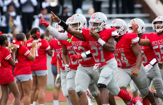 The Bosse Bulldogs take the field during the Bosse Bulldogs vs Vincennes Lincoln Alices game at Enlow Field Friday evening, Aug. 23, 2019.