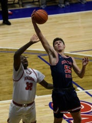 Blake Sisley (52), gaining a rebound against Bosse, had 21 points and 10 rebounds in Heritage Hills' 72-54 loss to Brownsburg Saturday in the Tipoff Classic at Southport.