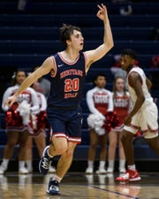 Heritage Hills' Cayden Kratzer (20) reacts to making a three-pointer during the second quarter of the River City Showcase against the Bosse Bulldogs at Screaming Eagles Arena in Evansville, Ind., Tuesday, Dec. 10, 2019. The Bosse Bulldogs fell to the Heritage Hills Patriots, 82-68.