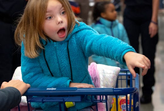 Sisily Dunn, 5, spots a toy during the Christmas with Kids shopping spree at Meijer in Evansville Tuesday morning, Dec. 10, 2019. The Vanderburgh County Sheriff's Office has put on the event – which now spends $300 on each of the 20 children invited from Ark Crisis Child Care Center – since 2001.