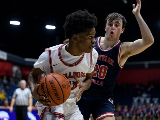 Bosse's Julian Norris (23) looks to make a pass around Heritage Hills' Cayden Kratzer (20) during the fourth quarter of the River City Showcase at Screaming Eagles Arena in Evansville, Ind., Tuesday, Dec. 10, 2019. The Bosse Bulldogs fell to the Heritage Hills Patriots, 82-68.