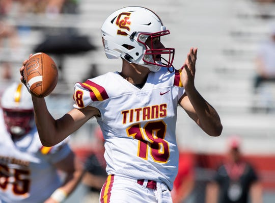Gibson Southern High School sophomore Brady Allen (18) drops back to pass during the first half of action in an IHSAA varsity football game at Southport High School in Indianapolis, Tuesday, Sept. 10, 2019.