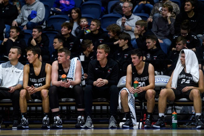 The Barr-Reeve Vikings bench including Curt Hopf, center, watches their team take on the Memorial Tigers during the River City Showcase at Screaming Eagles Arena in Evansville, Ind., Tuesday, Dec. 10, 2019. The Barr-Reeve Vikings defeated the Memorial Tigers, 76-37.
