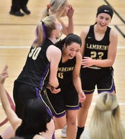 Fort Collins High School girls basketball players Laura Davis (30), Rachel Jones (0) and Shayne Young celebrate a buzzer-beating 3-pointer at the end of the third quarter by Jones in a game Tuesday, Dec. 10, 2019, at Windsor.