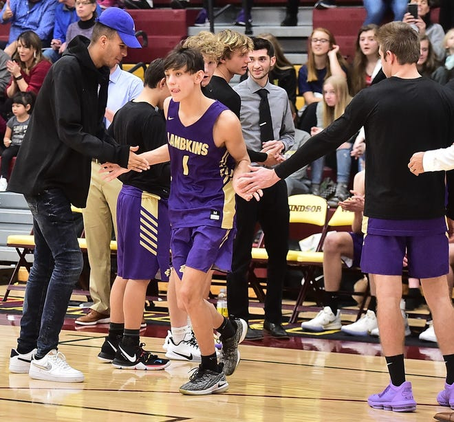 Fort Collins High School boys basketball player Raymond Johnson is introduced along with other starters before a game Tuesday, Dec. 10, 2019, at Windsor.
