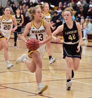Windsor High School girls basketball player Abby Bush drives past Fort Collins' Olivia Deines on her way to the basket during a game Tuesday, Dec. 10, 2019, at Windsor. The Wizards won the game 57-43 to kick off a sweep by the Wizards of the girls-boys doubleheader.