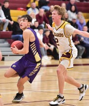 Fort Collins High School boys basketball player Raymond Johnson drives past Windsor defender Lance McGinnis before putting up a shot during a game Tuesday, Dec. 10, 2019, at Windsor. The host Wizards won the game 65-55.