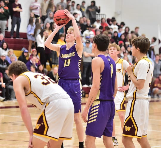 Fort Collins High School boys basketball player Jackson Bigge shoots a free throw during a game at Windsor on Tuesday, Dec. 10, 2019.