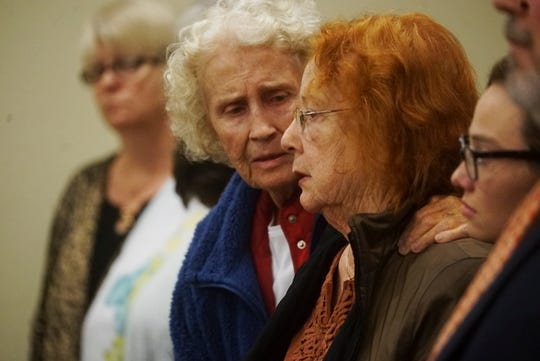 Bonnie Sievers, right, the mother of Mark Sievers reacts after the jury recommended the death penalty in the trial of her son on Tuesday Dec. 11, 2019.