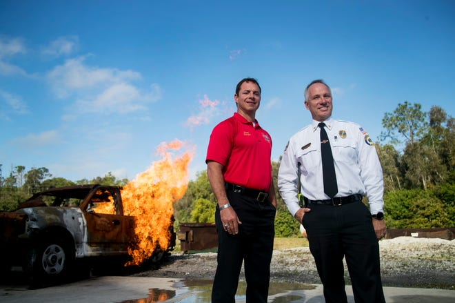 Joseph Daigle, left, is retiring as chief of the Bonita Springs Fire District. Greg DeWitt, who has worked with him for more than two decades is taking over as chief.