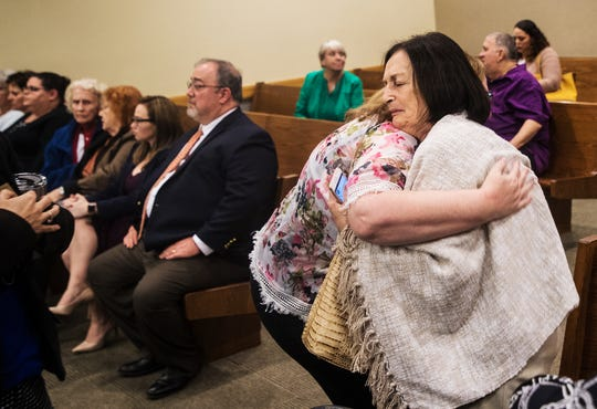 Mary Ann Groves, the mother of Teresa Sievers gets a hug after he jury recommended the death penalty in the trial of Mark Sievers on Tuesday Dec. 11, 2019.
